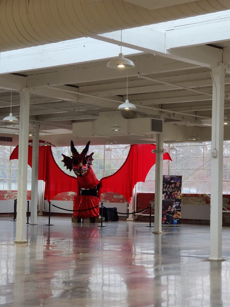 A large red dragon puppet made by Erindale Theatre at the University of Toronto Mississauga showcased at Small Arms Inspection Building