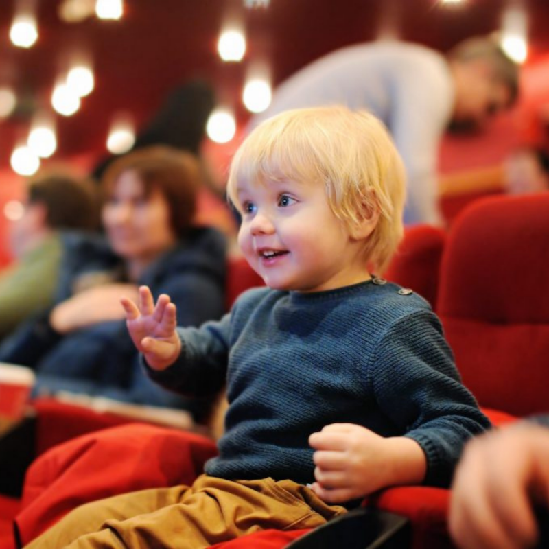 Child sitting in a theatre watching a live events in Mississauga and activities in Mississauga